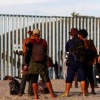 Caravan migrants reach US border