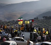 The Latest: 11 die in West Bank; clashes in east Jerusalem