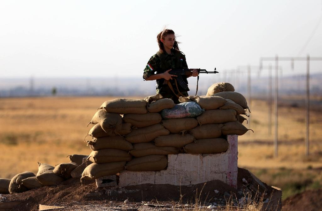 A Kurdish member of the Freedom Party of Kurdistan (PAK) keeps a position in Dibis, some 50 kms northwest of Kirkuk, on September 15, 2014