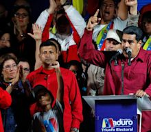 Nicolas Maduro filmed victoriously waving to an empty plaza after 'sham' election