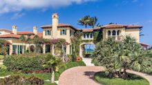 Inside Larry Ellison's new $80 million Palm Beach mansion, which sits in a high-security gated community and has 520 feet of ocean frontage