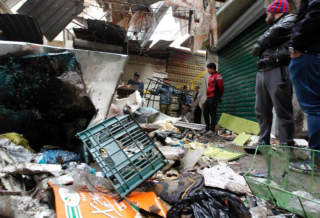 There was no immediate claim of responsibility for a double suicide bomb attack on Baghdad's central Al-Sinek area killing at least 27 people and wounding 53 (AFP Photo/SABAH ARAR)