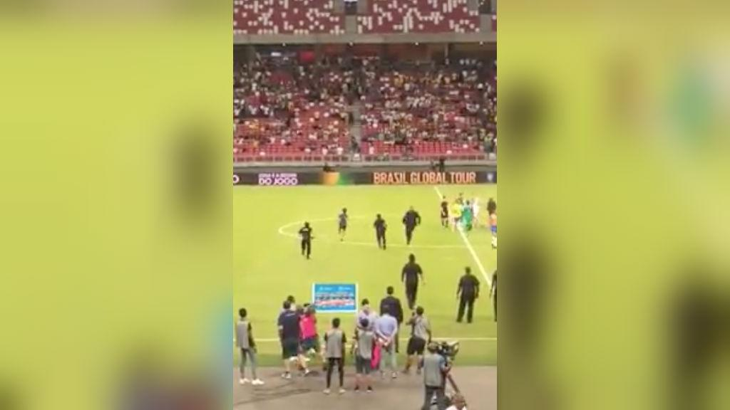 Man rushes football field during Brazil-Nigeria match, leads security guards on chase
