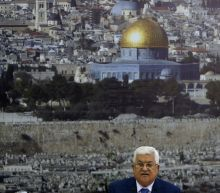Palestinian president Abbas improving in hospital: officials