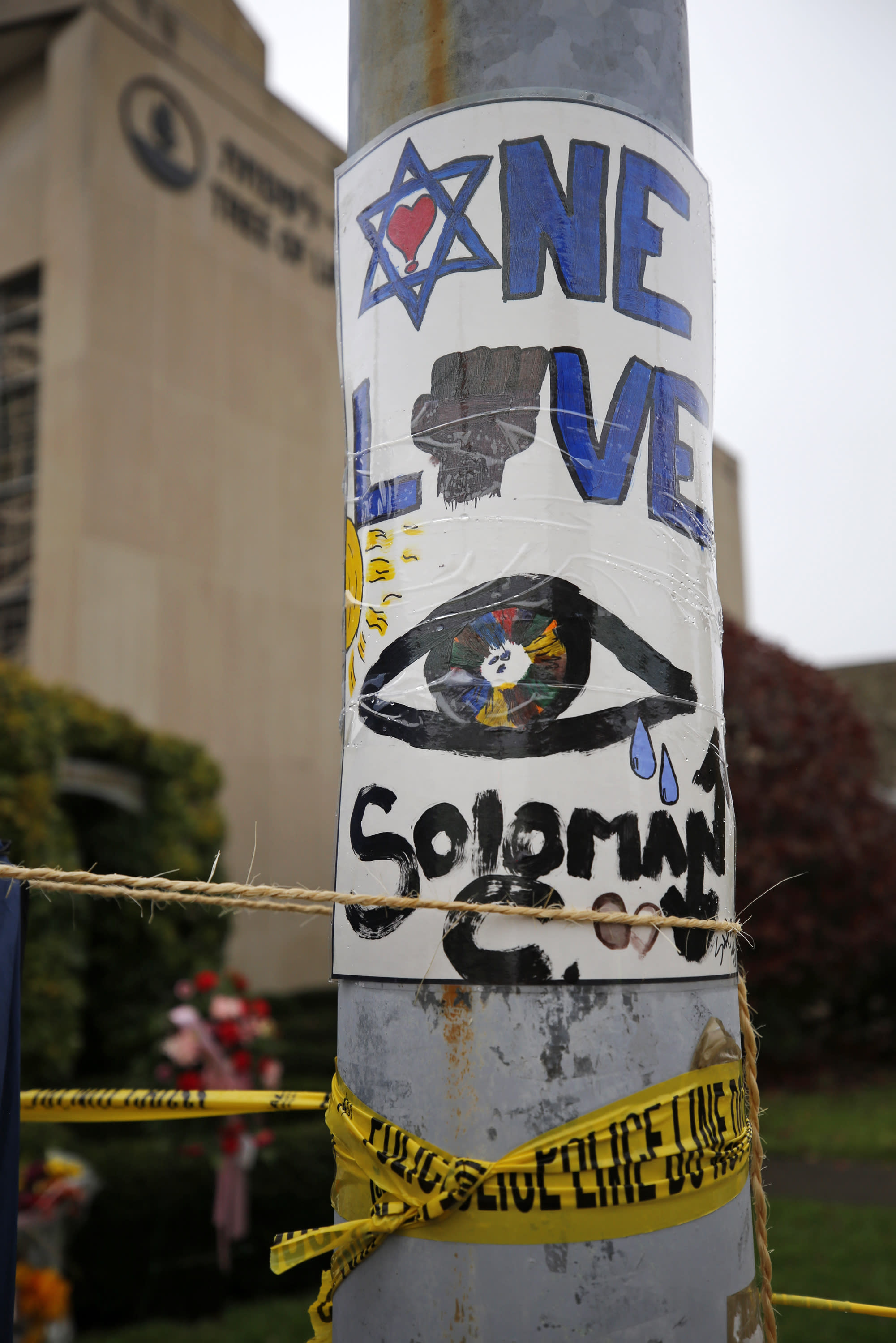 A sign is shown Thursday, Nov. 1, 2018, at a makeshift memorial outside the Tree of Life Synagogue to the 11 people killed Oct 27, 2018 while worshipping in the Squirrel Hill neighborhood of Pittsburgh. (AP Photo/Gene J. Puskar)