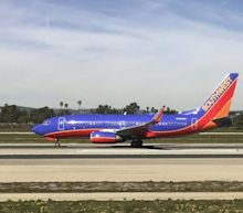 Plane Diverted After Passenger Tries To Open Emergency Exit