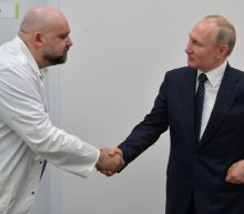A Doctor Who Met Putin Just Tested Positive, and Russia's COVID-19 Crackdowns Could Get Real Ugly.