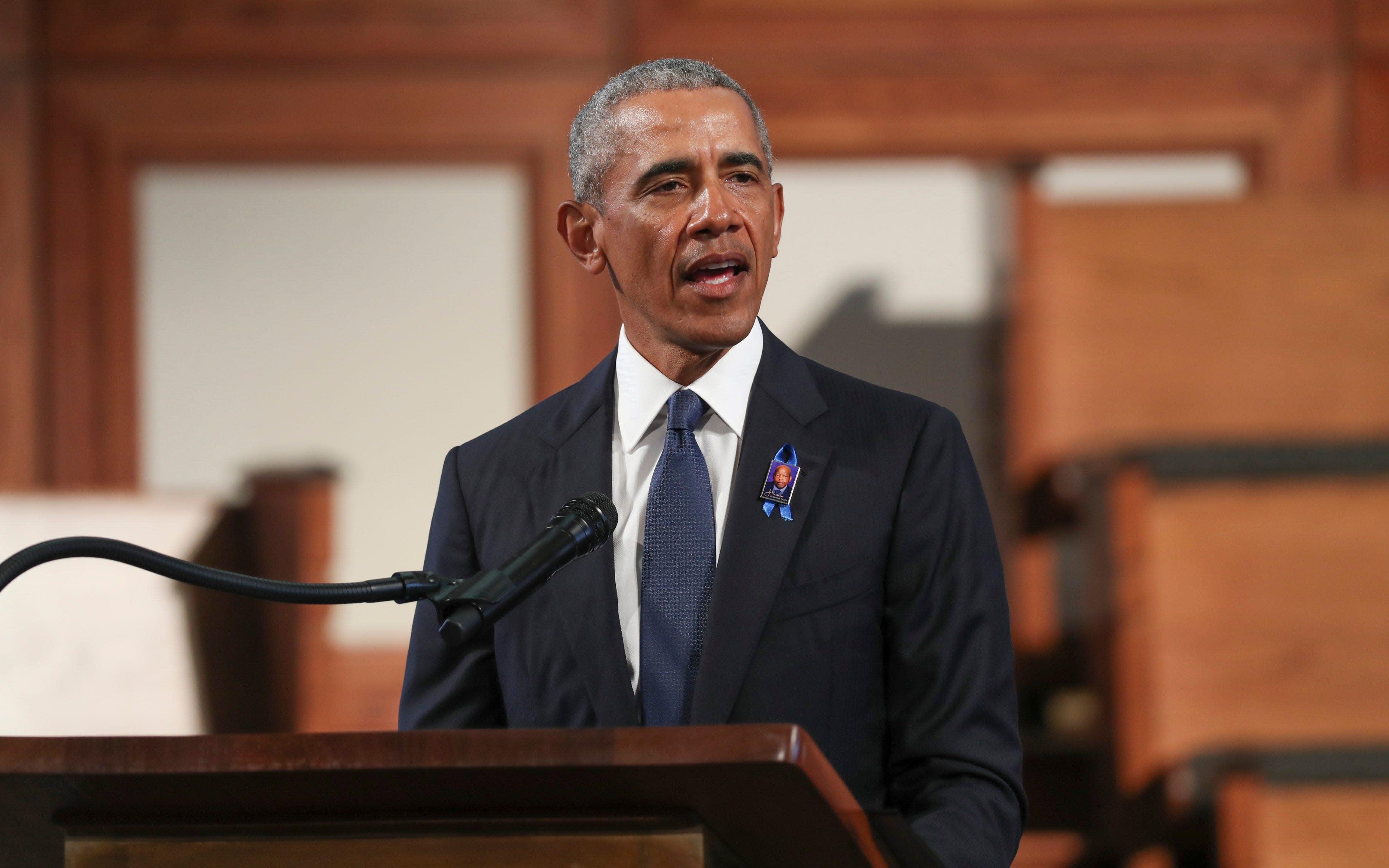 Former President Barack Obama delivers a rousing eulogy: 'America was built by John Lewises'