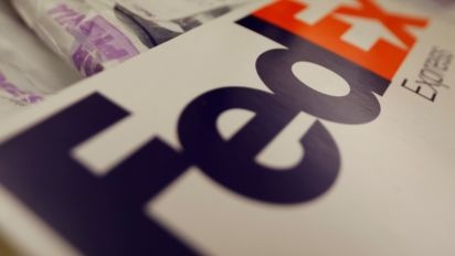 FedEx quarterly profit rises on higher rates