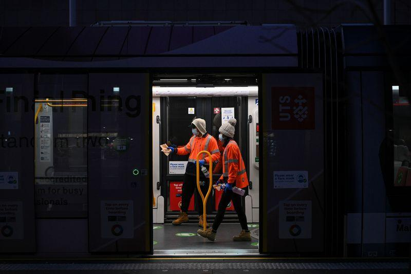 City workers sanitise the light rail at Circular Quay in Sydney