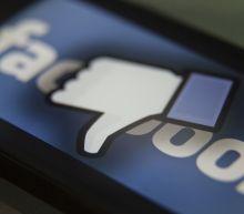 Facebook to tag 'harmful' posts amid ad boycott
