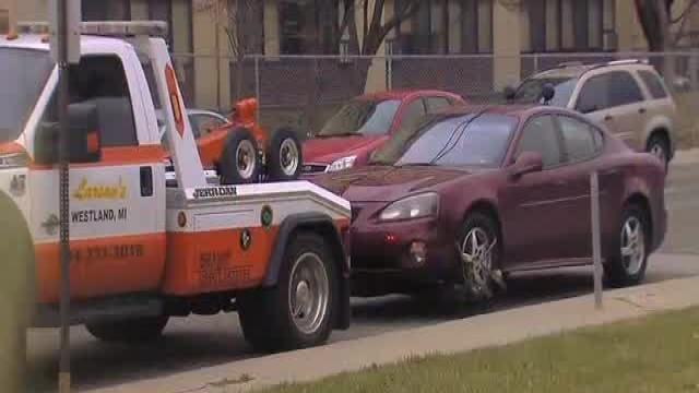 New questions surface about towing company hooking cars at a local strip mall