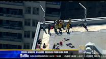 2 window washers rescued from downtown high rise