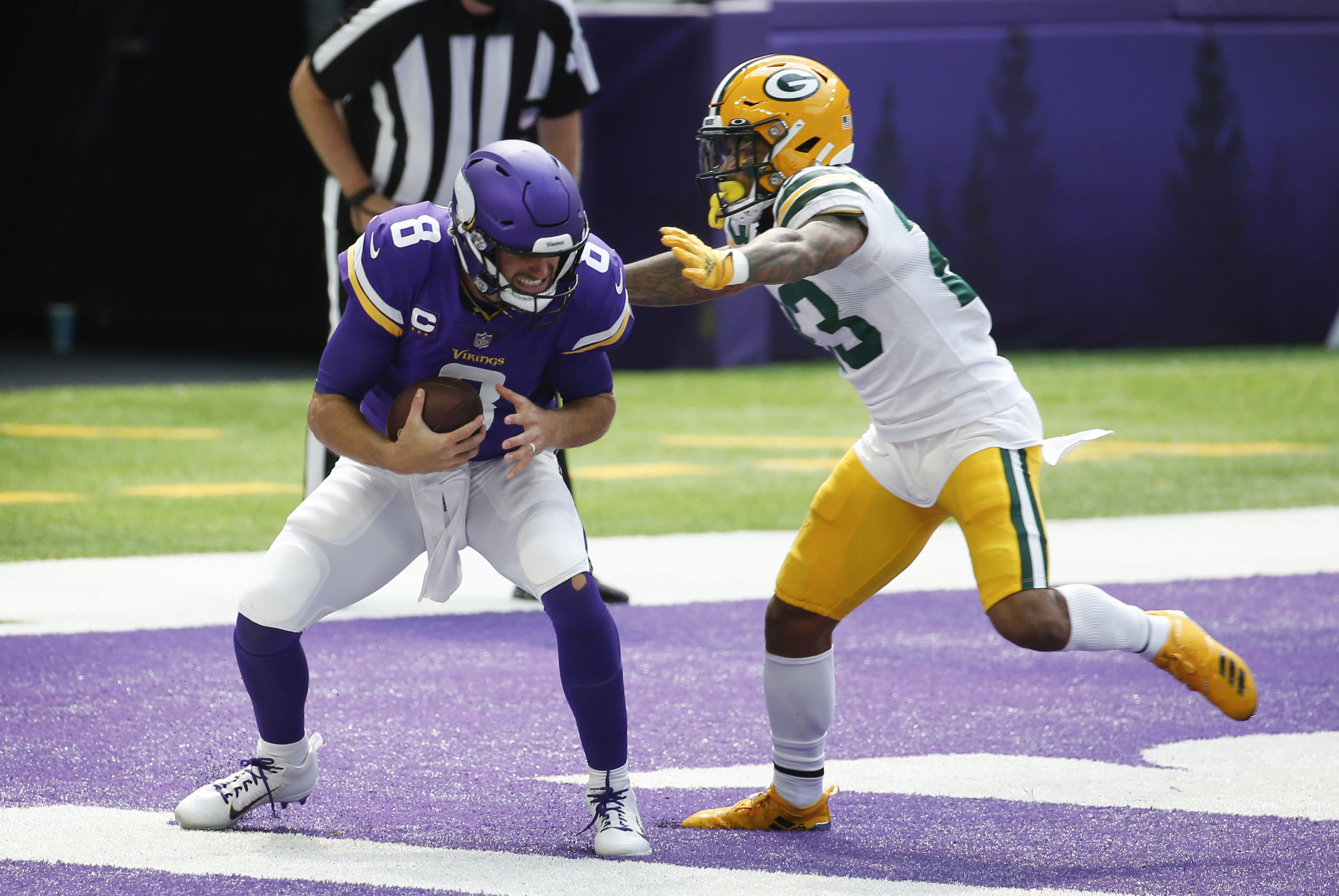 Green Bay Packers cornerback Jaire Alexander tackles Minnesota Vikings quarterback Kirk Cousins (8) in the end zone for a safety during the first half of an NFL football game, Sunday, Sept. 13, 2020, in Minneapolis. (AP Photo/Bruce Kluckhohn)
