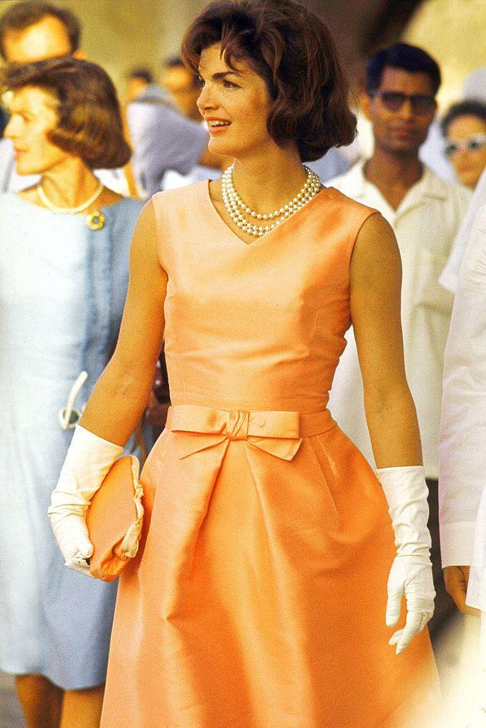 <p>During the height of her husband's presidency, the famed fashion figure wore a custom peach De la Renta piece with her signature pearls on an official visit to India. This sparked the decades-long tradition of Oscar de la Renta dressing America's First Ladies.</p>