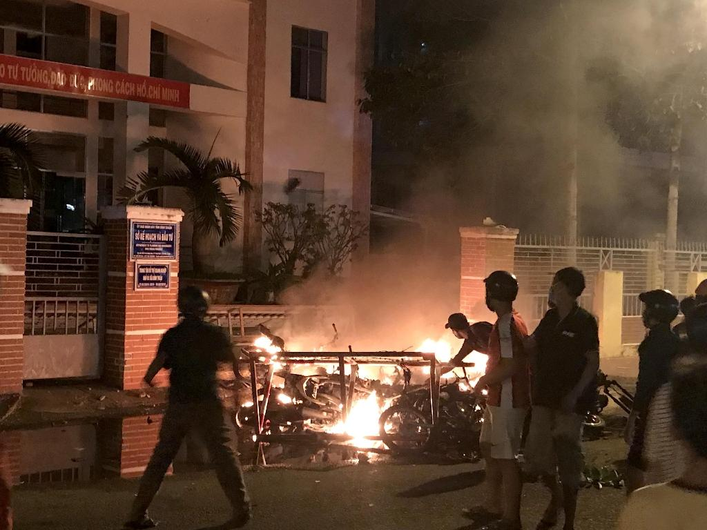 At least 40 people are in detention after the rallies in Vietnam, which turned violent in several spots including southern Binh Thuan province where demonstrators torched police buses and damaged government property