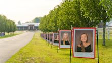 Principal decorates school driveway with huge portraits of graduating senior class: 'The world needs a hug right now'