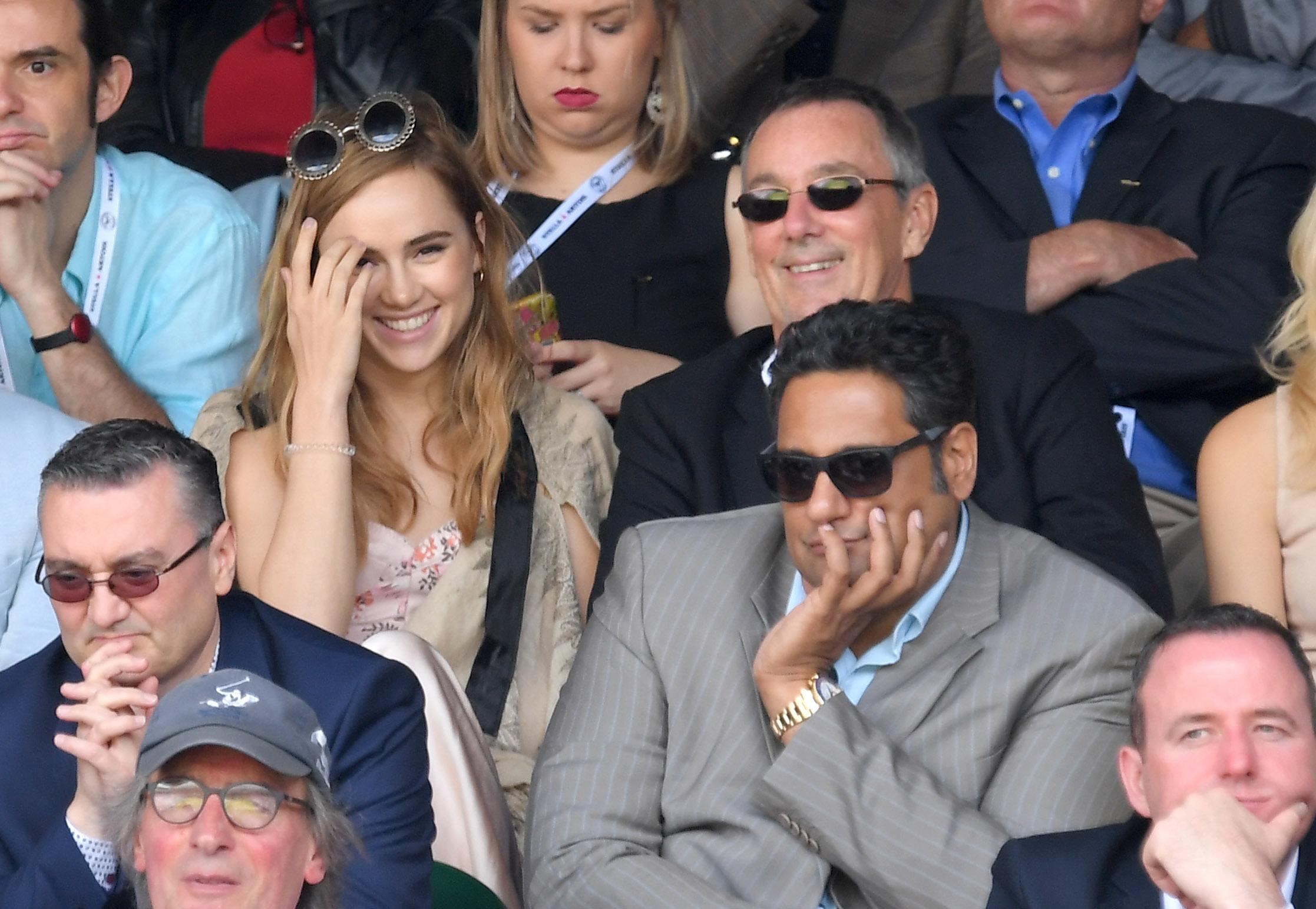 Suki Waterhouse watches the final.