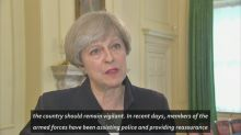 Theresa May reduces UK threat level to severe