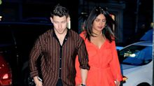 Priyanka Chopra Wears Orange Dress and Knee Brace For Date With Nick Jonas