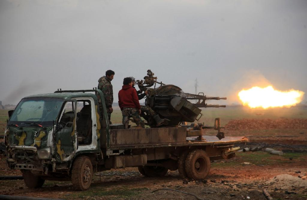 Syrian regime forces fire towards Islamic State (IS) jihadists south of the town of Al-Bab, in the northern province of Aleppo on January 14, 2016 (AFP Photo/George Ourfalian)