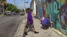 Tears and prayers at mural honoring Kobe Bryant and daughter