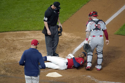 Minnesota Twins' Byron Buxton lies on the ground after being hit by a pitch from Cincinnati Reds' Lucas Sims during the eighth inning of a baseball game Friday, Sept. 25, 2020, in Minneapolis. (AP Photo/Jim Mone)