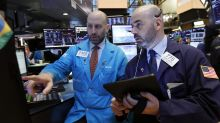 Wall Street: índices mixtos al mediodía