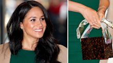 Fashion-forward Meghan Markle wears this season's new It bag brand