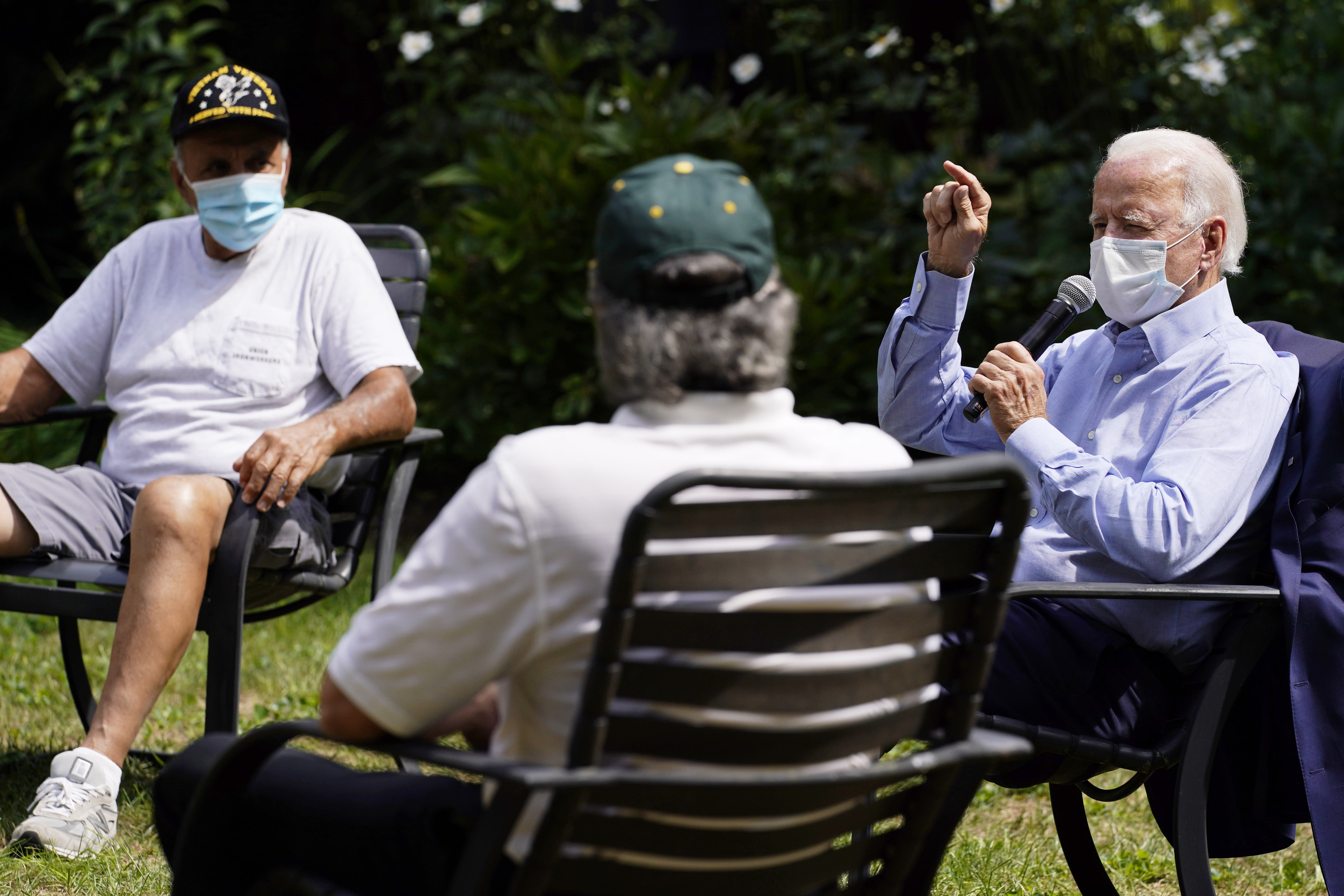 FILE - In this Sept. 7, 2020, file photo Democratic presidential candidate former Vice President Joe Biden speaks during an event with local union members in the backyard of a home in Lancaster, Pa. Campaigns are using different tactics in a pandemic election year unlike any other as candidates try to win over voters in down-ballot races that will determine control of Congress. Democrats, led by Biden, are keeping events small and mostly online. (AP Photo/Carolyn Kaster, File)