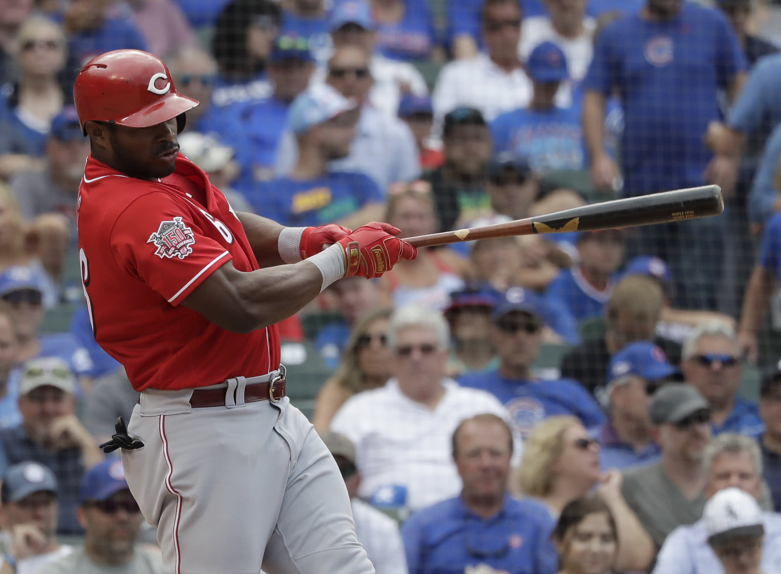 Cincinnati Reds' Yasiel Puig hits a one-run single against the Chicago Cubs during the eighth inning of a baseball game in Chicago, Wednesday, July 17, 2019. (AP Photo/Nam Y. Huh)