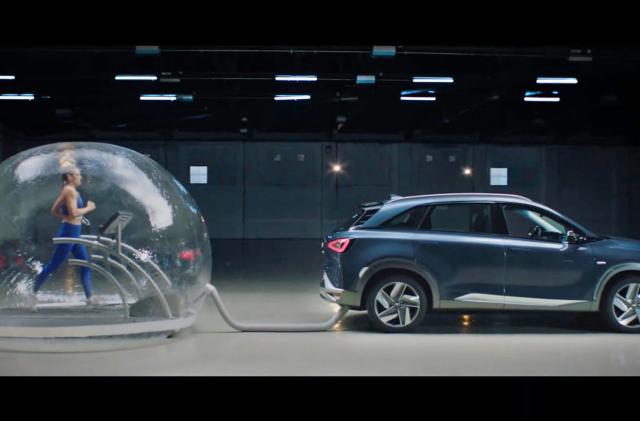 Watch an Olympian run in a bubble full of hydrogen car emissions