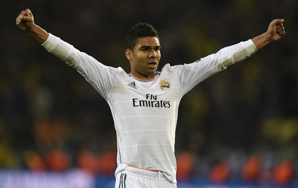 Real Madrid's Casemiro celebrates after the Champions League quarter-final match against Borussia Dortmund in western Germany, on April 8, 2014