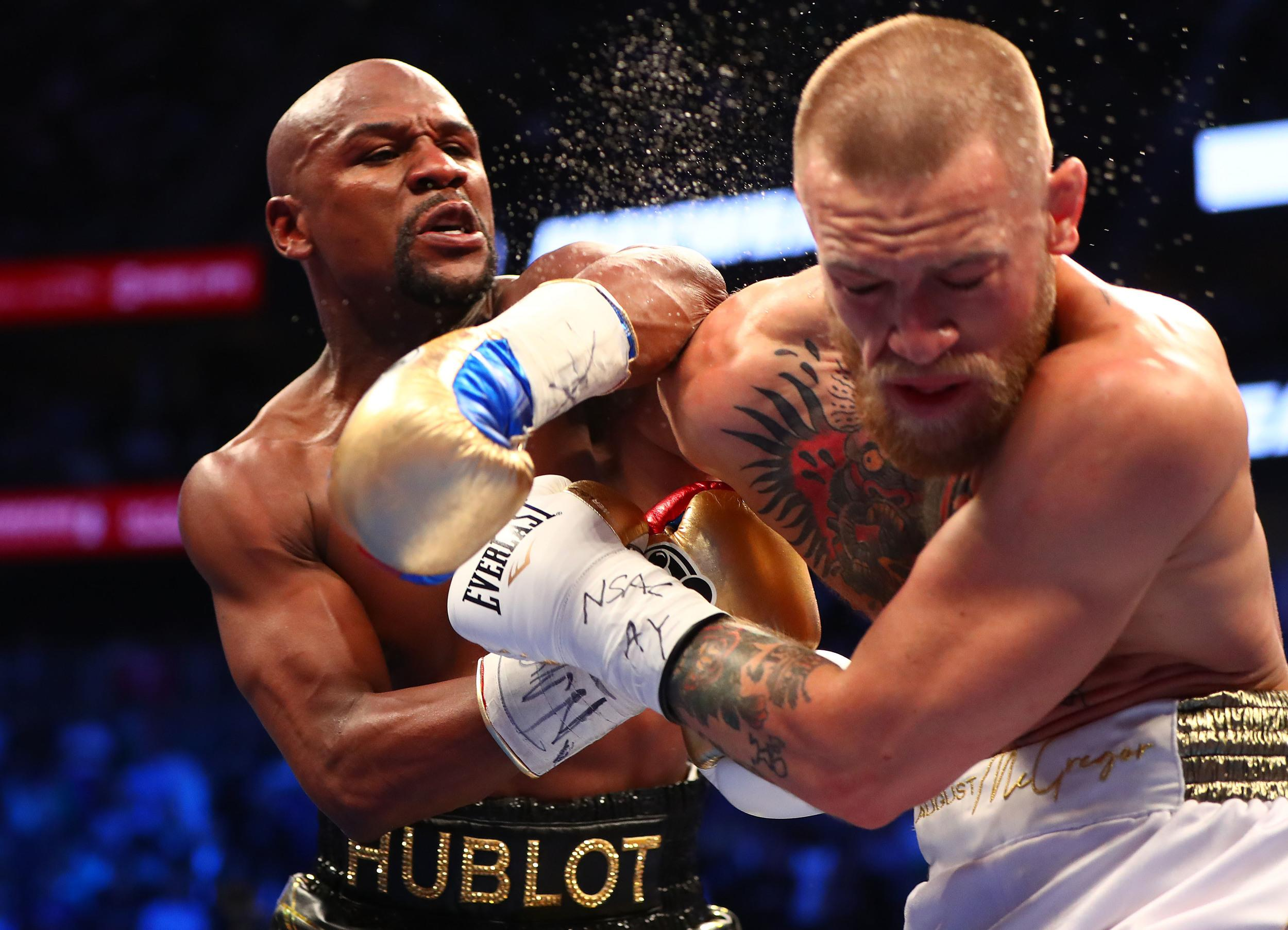 Aug 26, 2017; Las Vegas, NV, USA; Floyd Mayweather Jr. lands a hit against Conor McGregor during their boxing match at the at T-Mobile Arena. Mandatory Credit: Mark J. Rebilas-USA TODAY Sports/Sipa USA