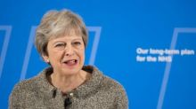 May faces down pro-EU rebel lawmakers to win Brexit vote