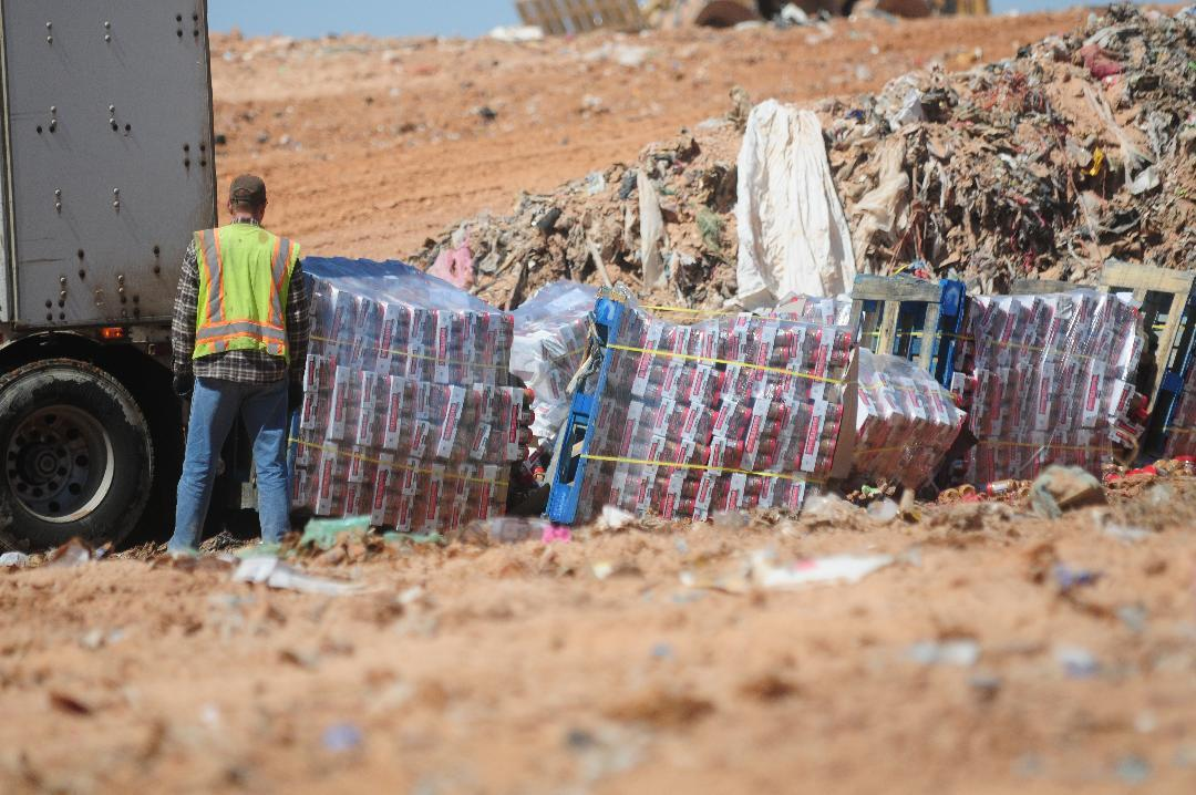 Peanut butter is disposed of Friday March 28, 2014 at the dump in Clovis, N.M. Nearly a million jars of peanut butter are being dumped at a New Mexico landfill to expedite the sale of a bankrupt peanut-processing plant that was at the heart of a 2012 salmonella outbreak and nationwide recall.(AP Photo/Clovis News-Journal, Tony Bullocks)