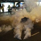 The Latest: Attackers beat Hong Kong protesters in subway