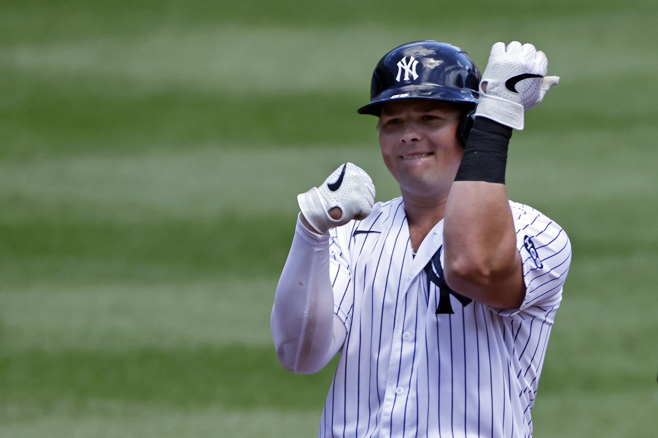 New York Yankees' Luke Voit reacts after hitting a double against the New York Mets during the first inning of the first baseball game of a doubleheader, Sunday, Aug. 30, 2020, in New York. (AP Photo/Adam Hunger)