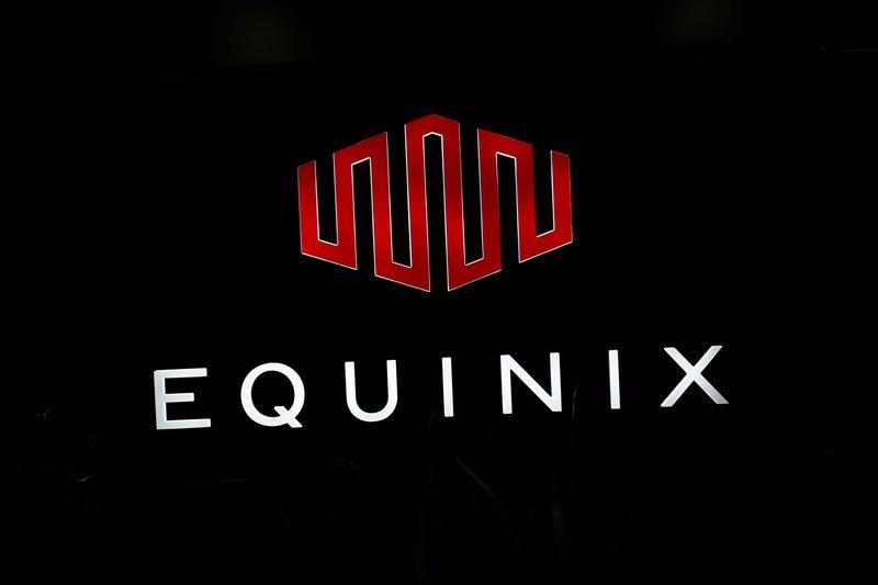 The logo of Equinix is pictured at the entrance of a data center in Pantin