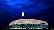 Several injured as Greenpeace protester parachutes into Germany-France match