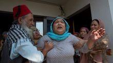 Photo of toddler sitting on slain grandpa angers Kashmiris