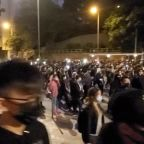 Hong Kongers light up streets with glowing mobile phones as protesters rally again in their thousands