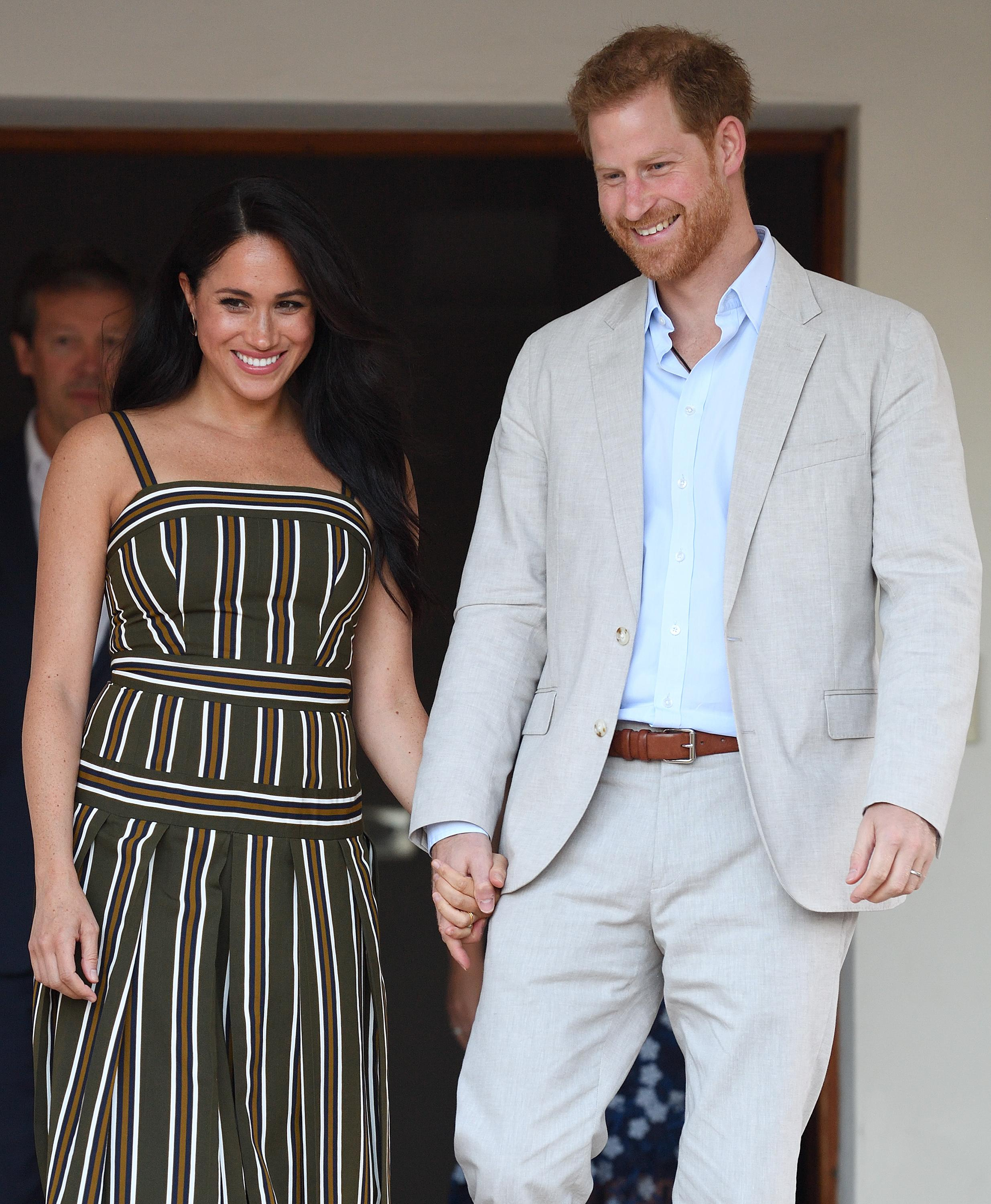 Prince Harry and Meghan Markle threaten legal action over paparazzi photos of her hiking with Archie: 'There are serious safety concerns'