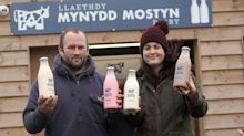 Police clear customers buying milk from farm shop vending machine with 'COVID fines warning'