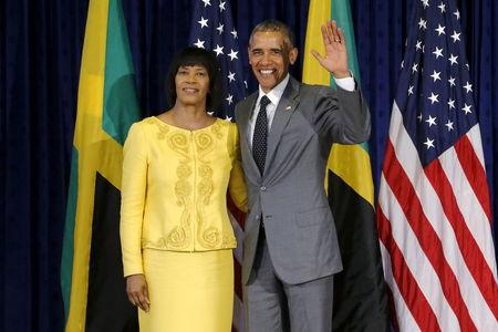 U.S. President Barack Obama stands for a photograph with Jamaica's Prime Minister Portia Simpson Miller upon his arrival at Jamaica House in Kingston April 9, 2015. REUTERS/Jonathan Ernst