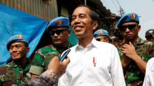 Police fire tear gas to disperse crowds after Indonesia confirms president's re-election