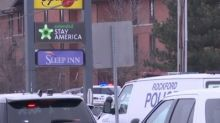 Gunman fled Ill. hotel after shooting officer