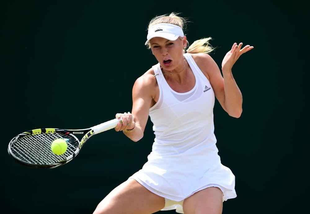 Denmark's Caroline Wozniacki returns to Czech Republic's Barbora Zahlavova Strycova during their women's singles fourth round match on day seven of the 2014 Wimbledon Championships in Wimbledon, southwest London, on June 30, 2014