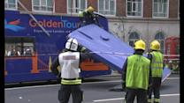 Roof ripped off London tourist bus