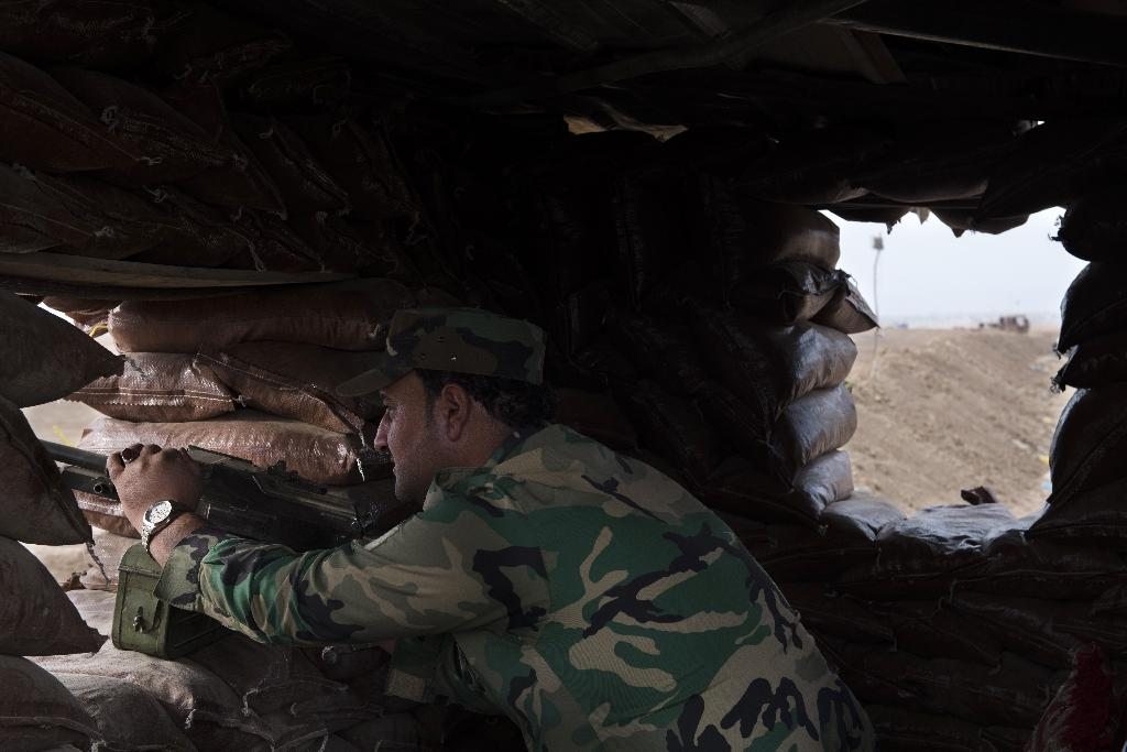 A Peshmerga soldier mans a fortified position along the berm (AFP Photo/Odd Andersen)